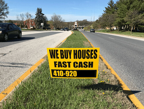 We buy houses signboard