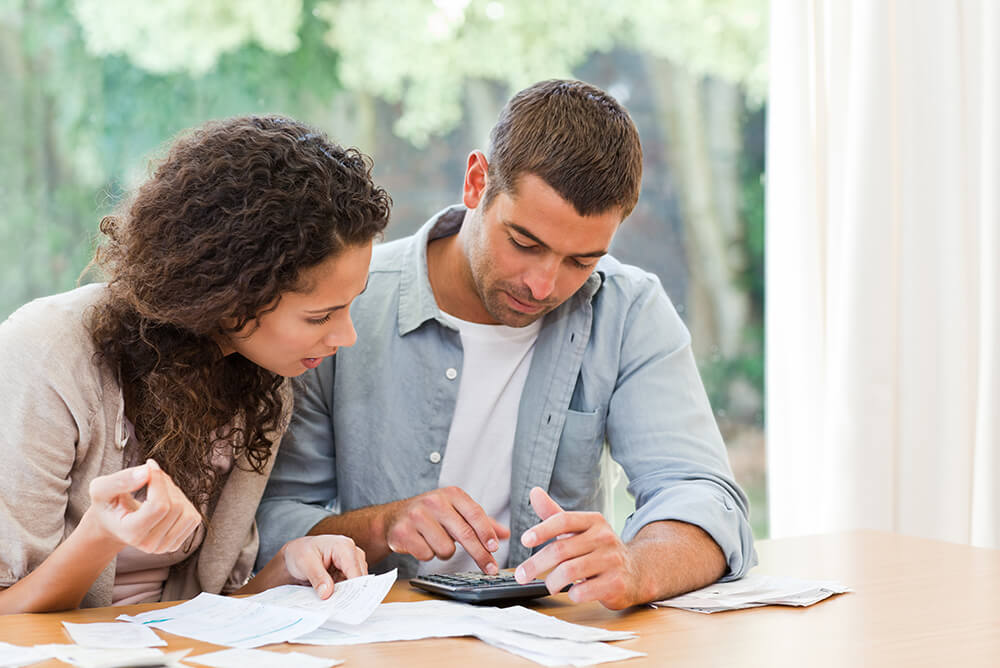Couple doing mortgage closing costs